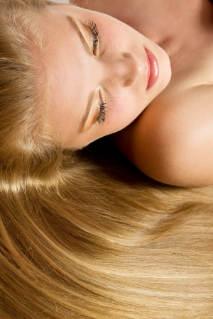 flaxen: Beautiful Blond Girl Close-up. Blonde Healthy Hair. Stock Photo