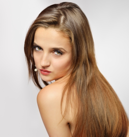 Brown Hair. Beautiful Woman with Healthy Long Hair Stock Photo