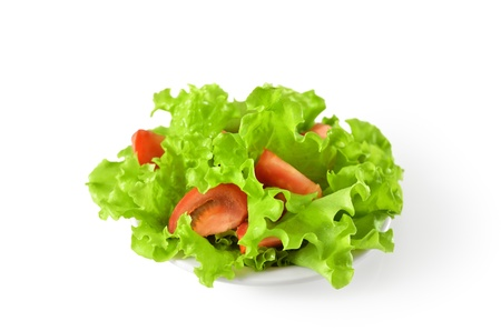 vegetable salad with tomatoes in plate photo