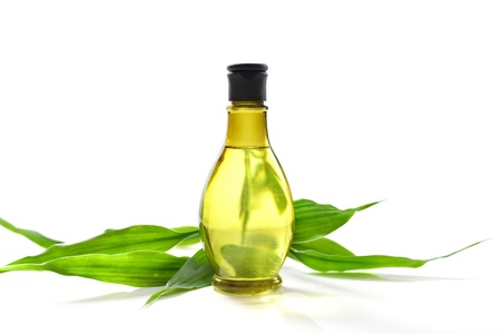Spa treatment with bottle and green bamboo Stock Photo