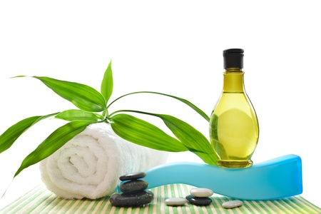 Spa treatment with towels and green bamboo isolated on white background. High resolution image.