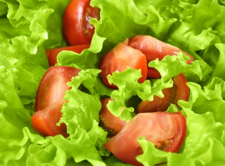 Background of healthy food. Salad closeup of fresh tomatoes