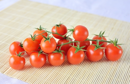 fresh cherry tomatoes on bamboo background