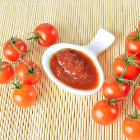 Ketchup and tomatoes. Top view. Stock Photo