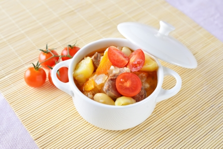 home made vegetable soup with potato, carrot, tomatoes and meat