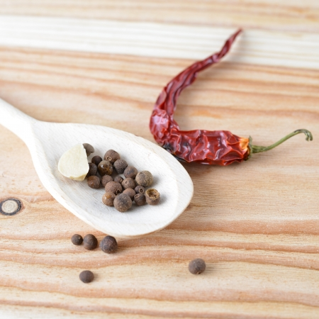 Black pepper on wooden background Stock Photo