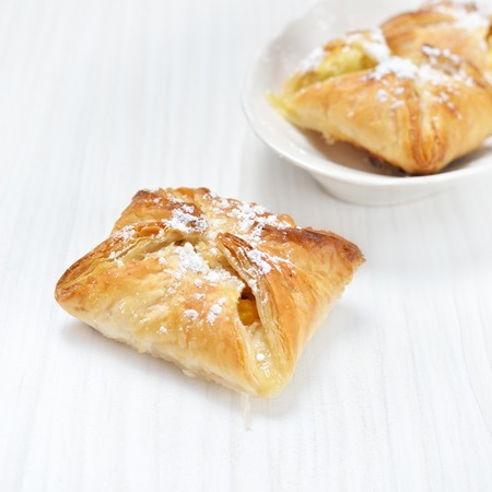 Puff pastry on the wooden white table Stock Photo