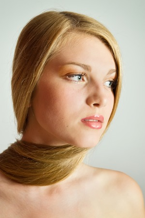 Blond Hair.Close-up portrait of beautiful Woman with Straight Long Hair Stock Photo