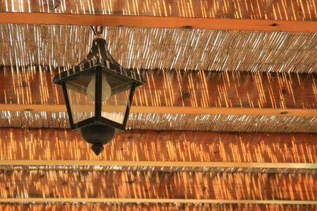 haulm: Lantern under a haulm roof Stock Photo