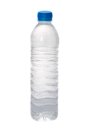 Clear bottle of water on white  photo
