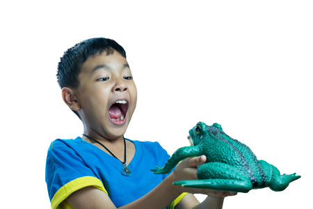 scare: Asian kid holding toy frog and look very scare