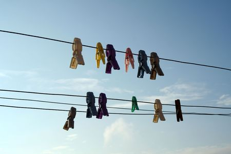 Fish shaped cloth clips hung on drying lines photo