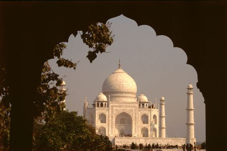 edifice: Dark arched frame to magnificent marble edifice Taj Mahal