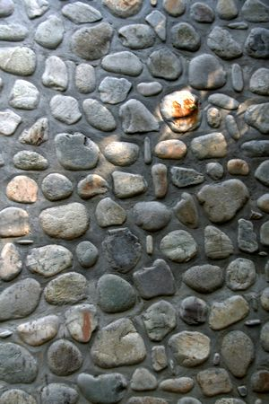 embed: Wall decor with stone pebbles of various shapes and sizes