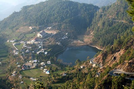 View of lake surrounded by mountains near Nainital, Uttarakhand State, India