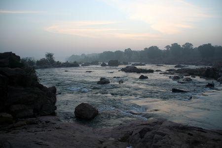 expanse: Vast expanse of river water flowing through rocks ferociously