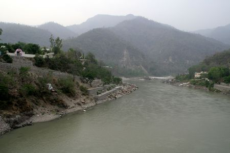 After flowing through the mountainous region, river Ganga starts her journey in plains near Rishikesh in Uttarakhand, India, Asia Stock Photo - 4434664