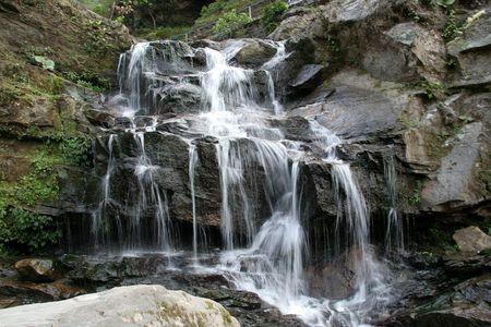Beautiful pattern of water flowing through rocks photo