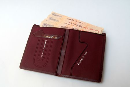 Brown wallet containing Indian currency notes isolated on whiteUploaded on 01apr09Not selected photo