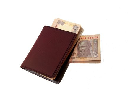 Indian currency notes and brown wallet separated on white background photo