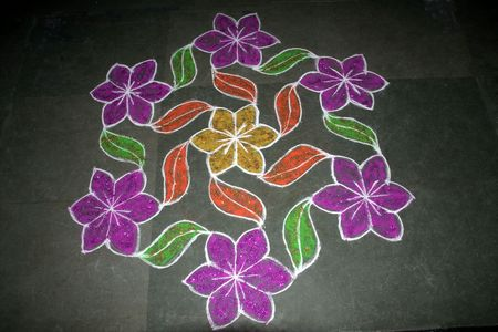 Creation of flowers and leaves in Rangoli art using stone powder mixed with colour Stock Photo - 5528844