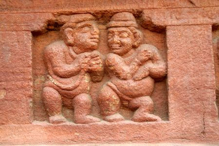 dwarfs: Stone carving of dwarfs on the base wall of cave temple at Badami in Karnataka, India, Asia