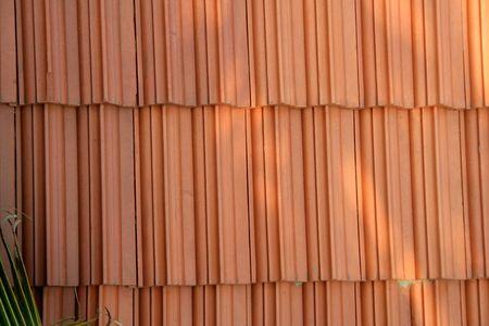 brownish: Pattern and texture of brownish red roofing tiles Stock Photo
