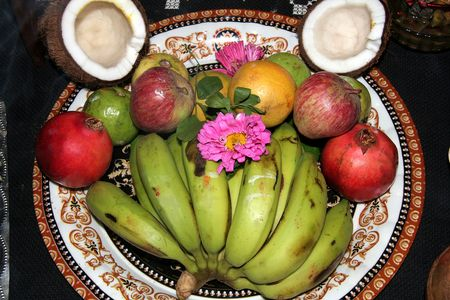fervour: Offering of fruits. flowers and broken coconut shells to God after performing Puja