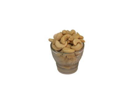 cashew tree: Cupful of cream coloured, edible, kidney-shaped nuts from cashew tree