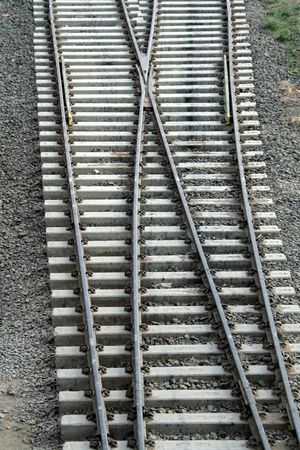 Cross-over of railway tracks laid on concrete sleepers photo