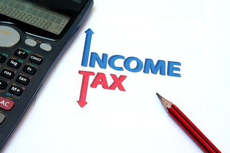 Managing money by maximising income and minimising tax liability Stock Photo