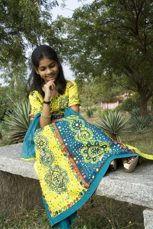 long skirt: An Indian girl in exquisitely embroidered long skirt