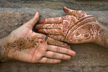 Mehandi art, painting on hand and feet with juice of a herb, is very common throughout India