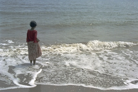 A little girl keenly watching the waves at beach Stock Photo - 10734811