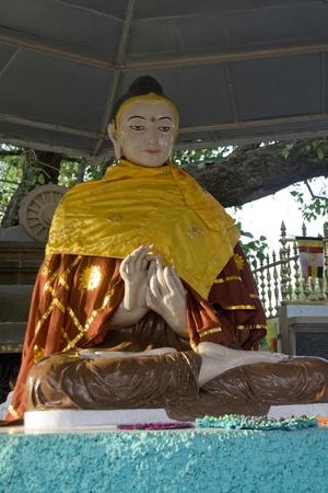 exalt: Statue of Buddha in serene, blessing mood at Saranath, Uttar Pradesh, India, Asia