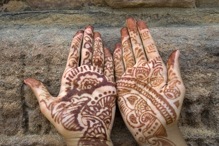 mehandi: Mehandi art, painting on hand and feet with juice of a herb, is very common throughout India