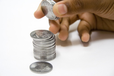 Build a big fortune by saving coins bit by bit Stock Photo - 11077140