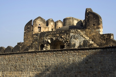 Top portion of the Fort seen behind wall, Jhansi, Uttar Pradesh, India, Asia Stock Photo