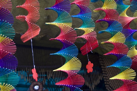 airstream: Attractive hangings made of multi-color sticks which spin when wind passes through