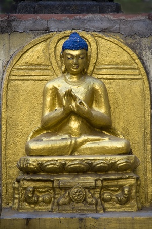 Golden statue of Buddha sitting in calm composition at Mahabodi Temple, Bodhgaya, Bihar, India, Asia
