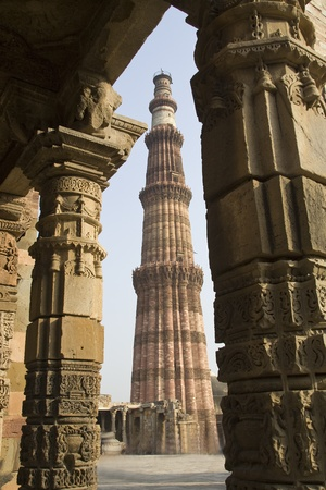 Qutub Mianar viewed through pillars of nearby structure in Delhi, India, Asia Stock Photo - 13022156