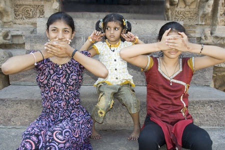 "Three Indian girls conceptually depicting an old adage ""Speak no evil, Hear no evil and See no evil"""