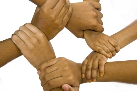 jointly: Conceptual shot of kids gripping their hands together in support of common cause