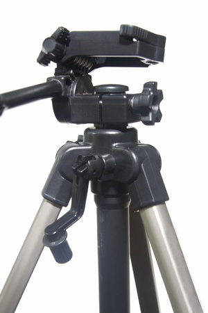 rigidity: View of camera stand head featuring mounting plate, rotating levers and tightening knobs
