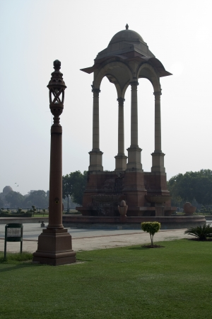 india gate: Stone pillars supporting canopy and lamp post near India Gate in New Delhi, India, Asia Stock Photo