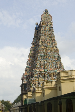 extensively: Temple tower, extensively sculpted with religious figures, at Meenakshi Temple, Madurai, Tamil Nadu, India, Asia