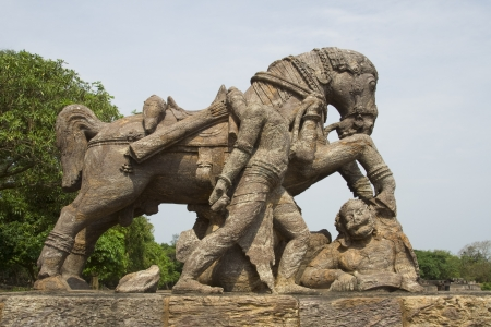 Rock sculpture of horse crushing a soldier during war at Sun Temple, Konark, Orissa, India, Asia Stock Photo - 16947133