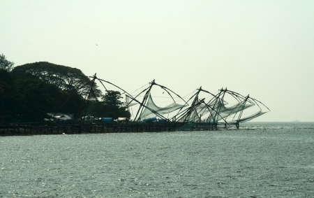 chinese fishing nets: Chinese Fishing Nets on sea coast at Kochi, Kerala, India, Asia Stock Photo
