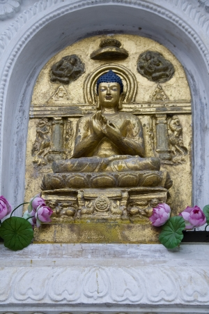 Buddha in Abhaya Mudra-Assurance Pose- on wall panel at Mahabodi Temple, Bodhgaya, Bihar, India, Asia Stock Photo - 23245060