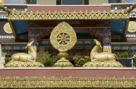 asia deer: Buddhist icons deer and Dharma Chakra at Namdroling Monastery in Bylakuppe, near Kushalnagar, Mysore District, Karnataka, India, Asia Stock Photo